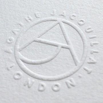 Embossed AJ monogram